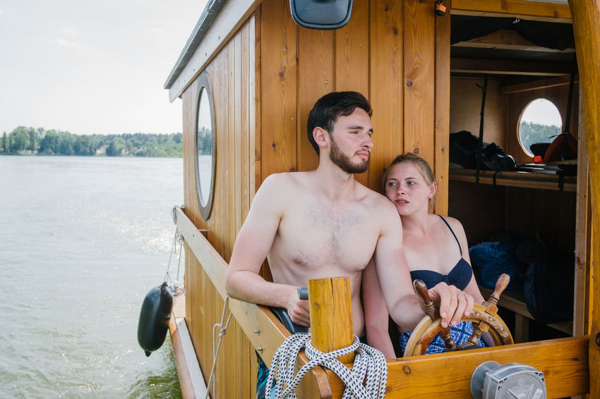Hausboottour in Lindow / Brandenburg Friends The Great Outdoors - 2018 EyeEm Awards The Portraitist - 2018 EyeEm Awards The Traveler - 2018 EyeEm Awards Youth Adult Boat Bonding Couple - Relationship Emotion Friendship Hausboot Leisure Activity Lifestyles Love Men Outdoor Outdoors Positive Emotion Real People Shirtless Sitting Smiling Three Quarter Length Togetherness Transportation Two People Water Young Adult Young Men Young Women
