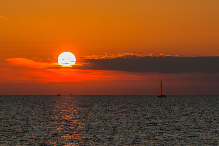 Sailing into the sunset Adriatic Sea Beauty In Nature Day Dramatic Sky Horizon Over Water Nature No People Orange Color Orange Sky Outdoors Sailboat Sailing Scenics Sea Sky Slovenia Sun Sunset Tranquility Water