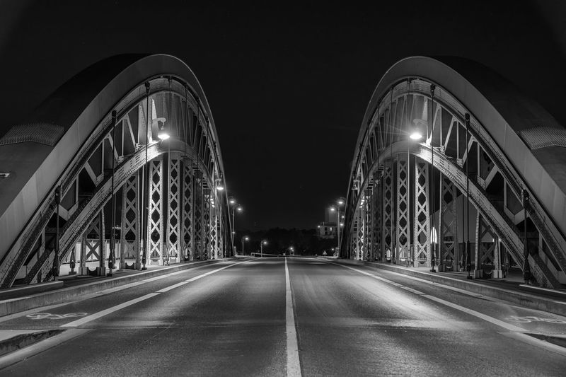 Street in Frankfurt Germany. Light and structure of this old iron bridge is a throwback to how well things can endure over time. Frankfurt EyeEm Selects Illuminated Night Direction The Way Forward Architecture My Best Travel Photo Transportation Built Structure Connection Bridge Bridge - Man Made Structure Arch Road Diminishing Perspective City Travel Destinations Street Long No People