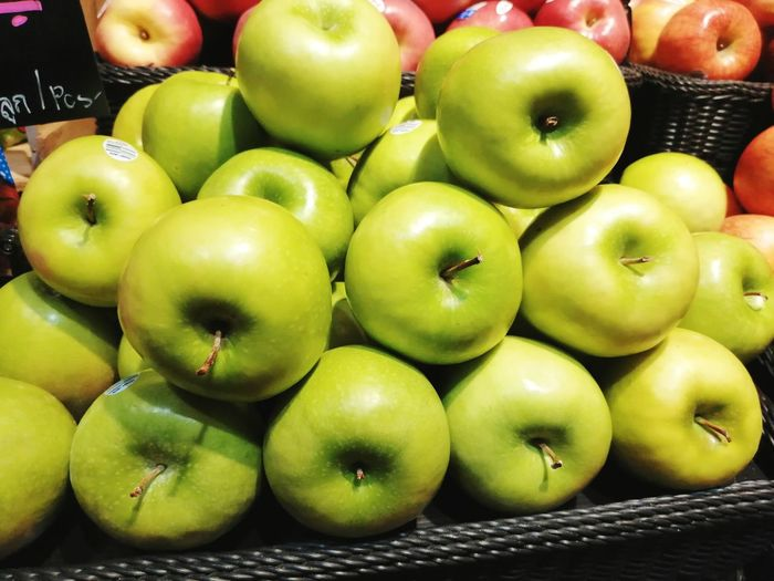Close-up of apples in market for sale