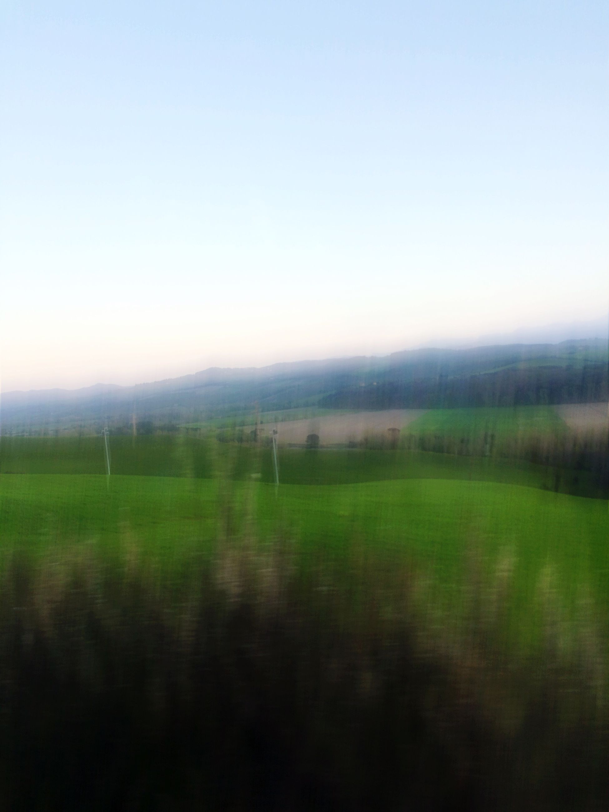 clear sky, copy space, landscape, tranquil scene, tranquility, field, scenics, beauty in nature, nature, grass, growth, idyllic, horizon over land, rural scene, foggy, no people, outdoors, non-urban scene, remote