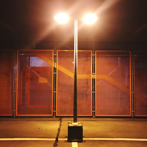 Mood EyeEmNewHere Parking Area Parking Garage Parking Lot Symmetrical Symmetry Geometric Urban Railing darkness and light Lantern Illuminated Night Lighting Equipment Street Light No People Built Structure Architecture Light Outdoors Metal Floodlight