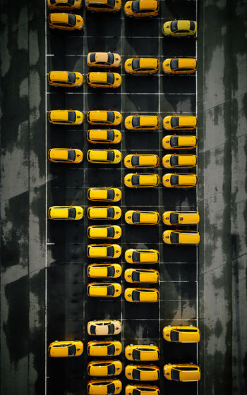Yellow bus on road by building