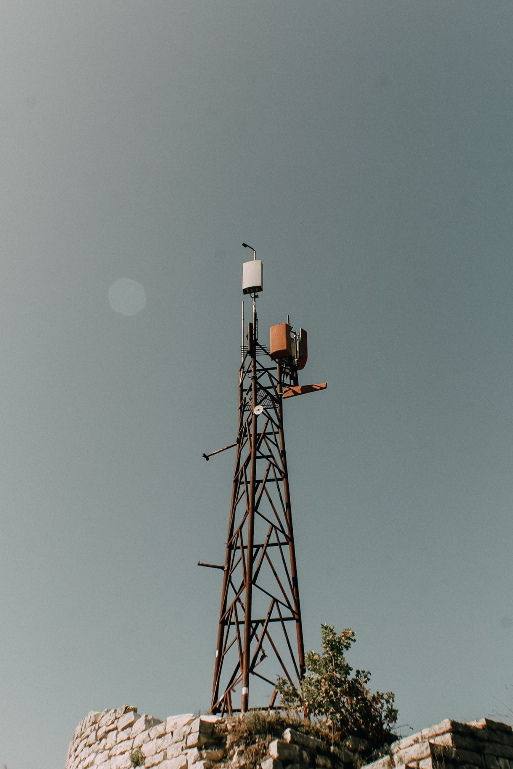 tower, sky, low angle view, built structure, architecture, tall - high, nature, no people, clear sky, copy space, technology, outdoors, day, building exterior, communication, lookout tower, observation point, safety, antenna - aerial, global communications