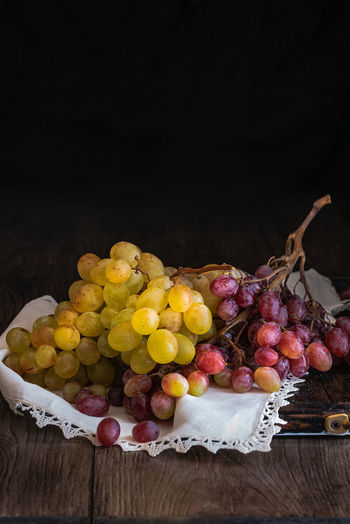 bunches of white and red grapes on a rustic base Autumn Bunch Of Grapes Dessert Natural Nature White Grape Close-up Closeup Fall Food Freshness Fruit Grape Healty Ingredient Juicy Fruit Leaf No People Organic Purple Ripe Seasonal Tasty Wellbeing Wine