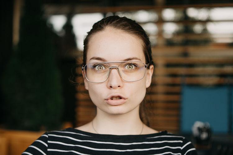 Portrait of beautiful young woman wearing eyeglasses