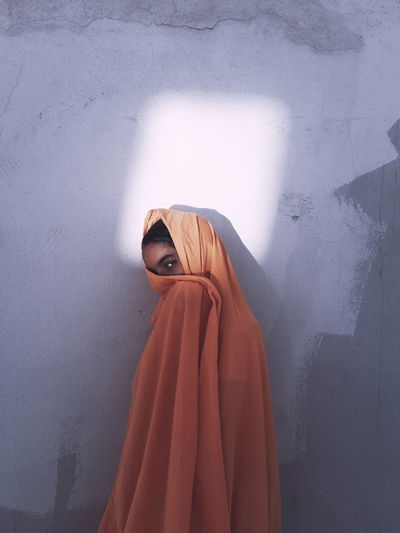 FATIMAZOHRA Adult Clothing Covering Front View Hood - Clothing Indoors  Leisure Activity Lifestyles Looking At Camera Obscured Face One Person Portrait Real People Standing Three Quarter Length Unrecognizable Person Wall - Building Feature Women Young Adult Young Women
