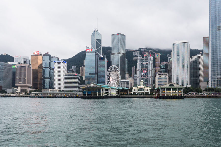 Hong Kong business district cityscape ASIA Business Hong Kong Star Ferry Pier Victoria Harbour Architecture Building Exterior Built Structure Business Finance And Industry City Cityscape Hong Kong Island Modern Office Building Exterior Outdoors Sky Skyscraper Star Ferry Travel Destinations Urban Skyline Water Waterfront