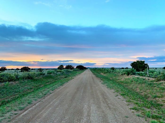 """Fade Into The Sunset"" A lonely county road in Central New Mexico fades into a vanishing perspective on a late Spring evening on the highlands. vanishing point Dirt Road Evening Sky Sundown Dusk Sunset_collection Sunset New Mexico Photography New Mexico New Mexico Skies Clouds And Sky Sky Cloud - Sky Landscape Environment Land Scenics - Nature The Way Forward Diminishing Perspective Beauty In Nature Rural Scene"