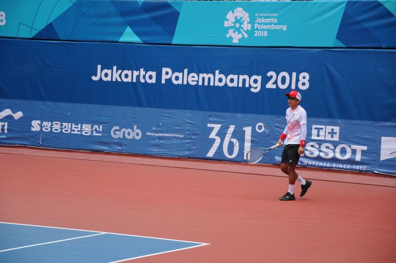 tennis player of indonesia Tennis Athlete Soft Tennis Asian Games 2018 Full Length City Politics And Government Text Capital Letter No Parking Sign Western Script Information Written Information Sign Arrow Sign Street Art Graffiti Directional Sign Stop Sign Stop - Single Word One Way Vandalism Do Not Enter Sign Alphabet Street Name Sign Sign Single Word Arrow Symbol Non-western Script Road Sign