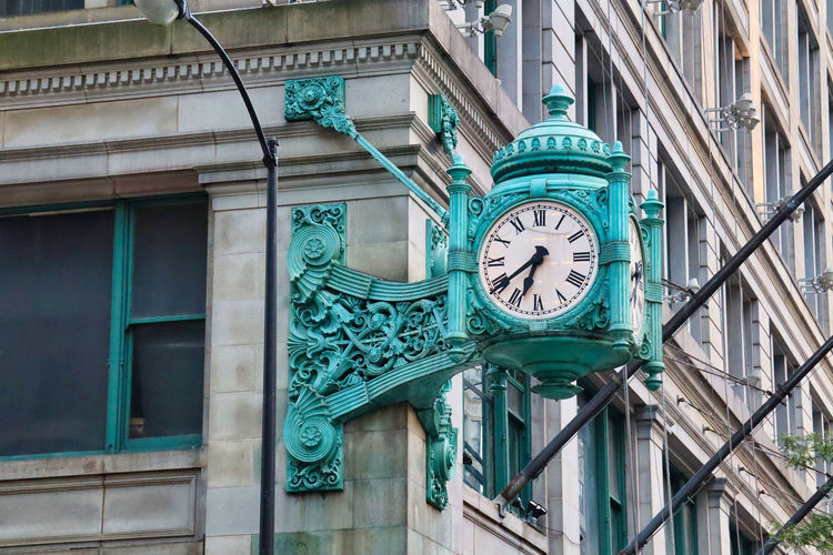 Low angle view of clock on building