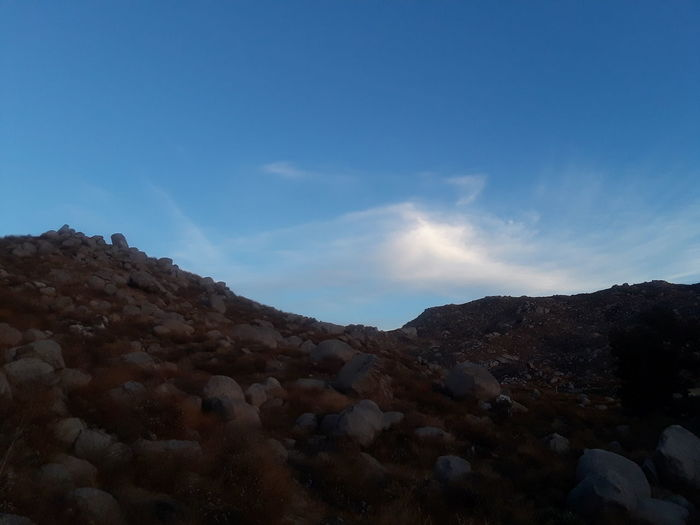 looking up to the sky for heavenly wisdom. Blue Sky And Clouds Blue Sky Rocks College Campus Mountain Sky Nature Landscape Desert No People Astronomy Outdoors Beauty In Nature Day Scenics