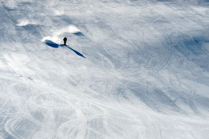 Fast skier racing downhill Copy Space Downhill Downhill Skiing Downhill Skiing Adventure Cold Temperature Day Frozen Ice Land Leisure Activity Lifestyles Mountain Nature One Person Outdoors Snow Snowcapped Mountain Sport Unrecognizable Person White Color