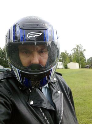 Safety Gear Motorcycle Helmet Leather Jacket Motorcycle Rider Blue Black Lawn Grass Green Storage Buildings Trees Sky