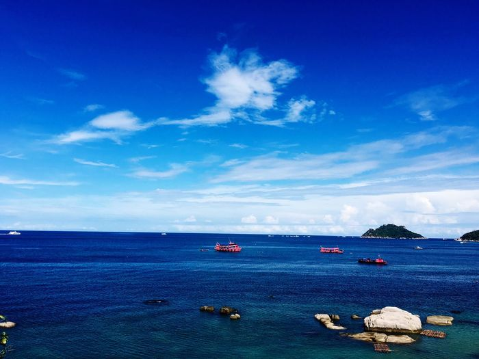 Red ships in the ocean Sea Blue Sky Water Nature No People Landscape Ship