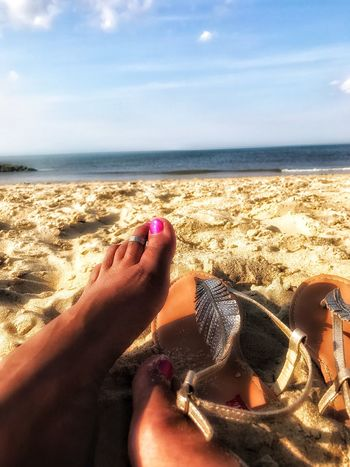 Beach Sea Human Body Part Sand Human Foot Lifestyles One Person Leisure Activity Real People Horizon Horizon Over Water Outdoors Nature Ocean Views Sandy Feet
