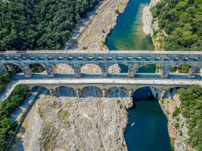 Pont du Gard, France (different angle) Dronephotography DJI X Eyeem Bridge Aerial View Aerial Shot Traveling Landscapes Landscape Landscape_Collection Beauty In Nature Eye4photography  EyeEm Best Shots Drone  Dji DJI Mavic Pro Droneshot France EyeEm Gallery Travel Pont Du Gard Pontdugard  Canal EyeEm Nature Lover Nature Nature_collection Naturelovers Drone Photography Water High Angle View Bridge - Man Made Structure