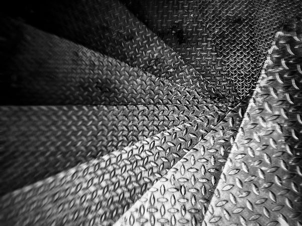In a dizzy way down to a creepy steel spiral staircase Backgrounds Black And White Circular Circular Stairway Close-up Creepy Dark Day Dizzy Full Frame Go Down Indoors  Look Down Misterious No People Pattern Point Of View Scary Spiral Staircase Spiral Stairs Textured  The Street Photographer Unexpected Way Way Of Life The Architect - 2018 EyeEm Awards