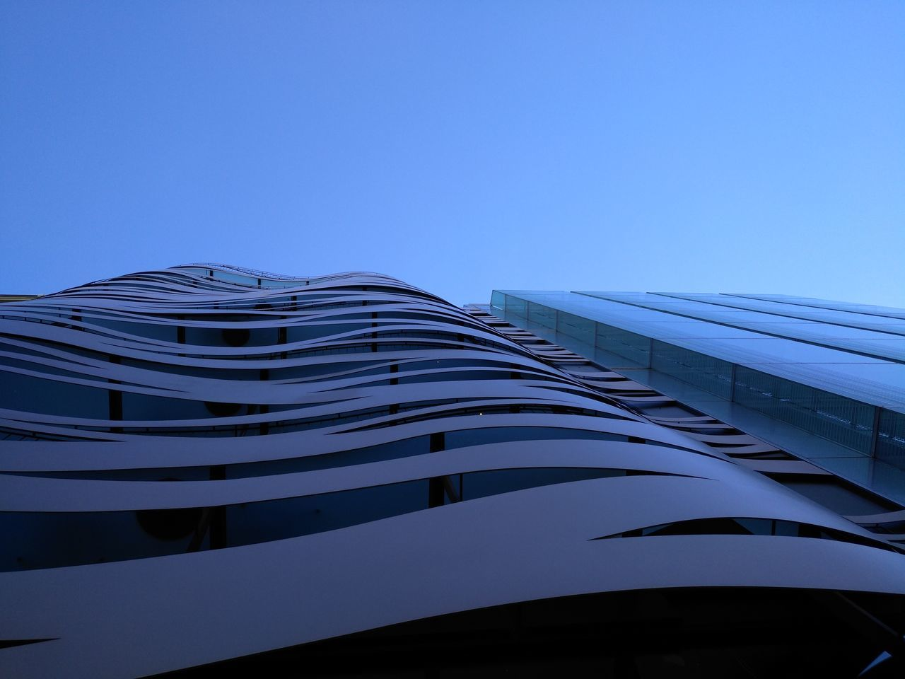 architecture, building exterior, built structure, copy space, low angle view, clear sky, blue, modern, no people, skyscraper, outdoors, day, city, sky