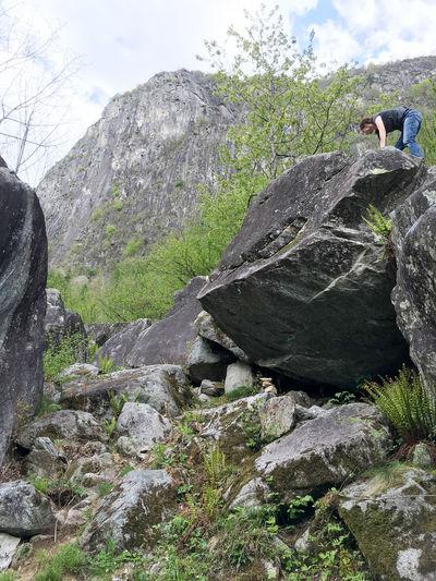 Rocks on cliff against sky