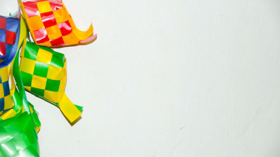 Ketupat ribbon in white background / Origin of Ketupat - A traditional rice wrapped by leaf and to be consume at the period of Hari Raya.(selective focus and soft focus). Indoors  Still Life Aidilfitri Arabic Art ASIA Backgrounds Background Caligraphy Card Celebration Coconut Decoration Design Dumpling  Eid Festival Food Grafic Green Greeting Happy Hari Raya Aidilfitri Hari Raya Holiday Islam Islamic Isolated Kareem Ketupat Leaf Malay Malaysia Mosque Mubarak Muslim Oriental Ornament Palm Pattern Pray Ramadan  Religion Religious  Rice Salam Selamat Hari Raya Spirituality Traditional Wallpaper