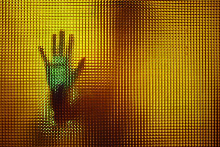 Human Hand On Glass