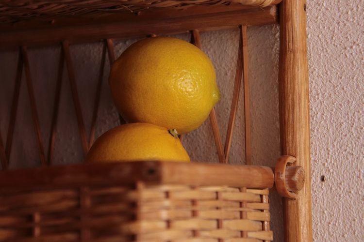 Close-up of orange fruit in basket