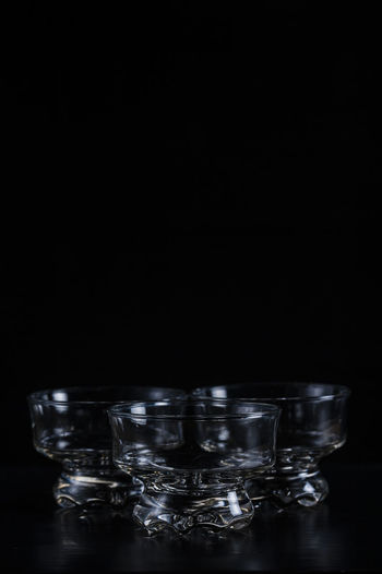 Glass Bowls Against Black Background