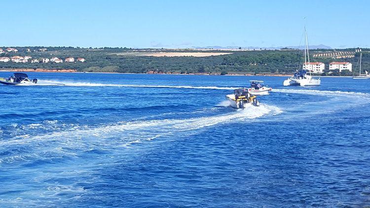 Blue Sea Water Sport Nautical Vessel Day Outdoors Beach Sky Real People Beauty In Nature Horizontal Yacht Cloud - Sky Sailing Ship Aquatic Sport Idyllic Cityscape Sailboat Catamaran Yachting