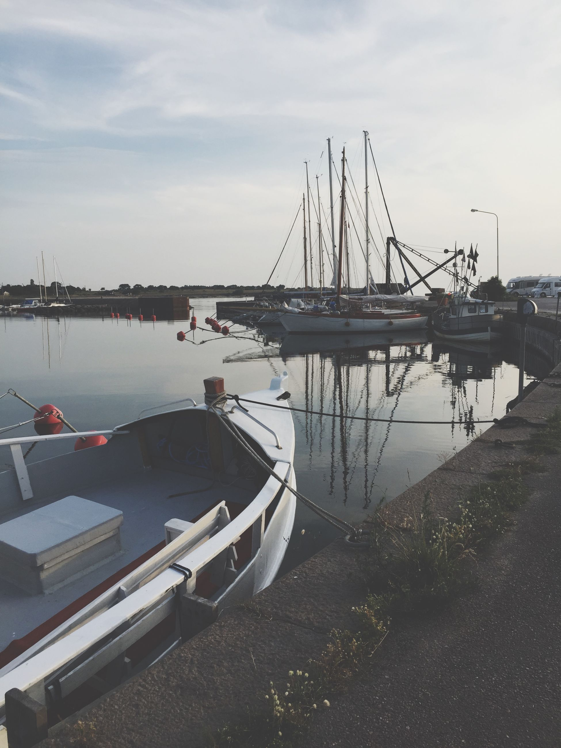 nautical vessel, transportation, water, moored, boat, mode of transport, mast, sky, harbor, sailboat, sea, nature, cloud - sky, lake, outdoors, no people, river, commercial dock, tranquility, day
