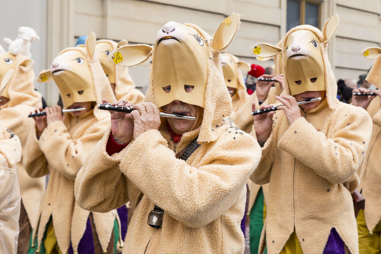 Steinenberg, Basel, Switzerland - March 8, 2017. Group of carnival participants in sheep costumes playing piccolo and marching down the street. Basel Basel, Switzerland Beige Carnival Carnival Crowds And Details City Colors Event Tourist Attraction  Candid Close Up Close-up Closeup Colorful Costume Group Of People Marching Mask - Disguise Musical Instrument People Real People Sheep Swiss Switzerland Traditional Festival