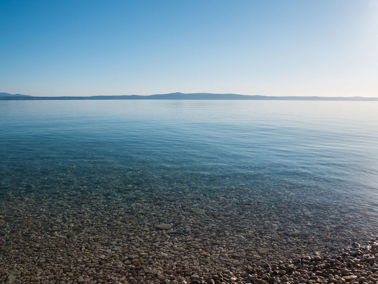 Blue Adriatic sea landscape with island Hvar at background Adriatic Beauty In Nature Blue Calm Croatia Dalmatia Holiday Horizon Over Water Island Landscape Mediterranean  Nature Nature No People Nobody Outdoors Scenics Sea Sky Summer Sunlight Tranquility Travel Vacation Water