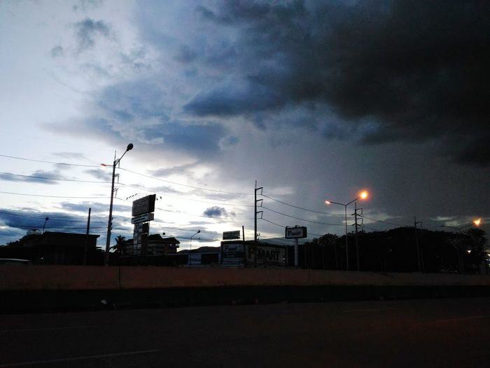 The Rain Is Coming Darkness And Light Clouds And Sky On The Road