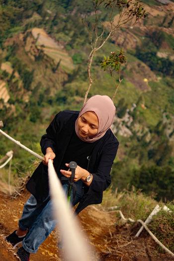High angle view of young woman hiking