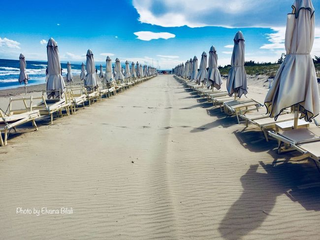 CastellanetaMarina Puglia Beach Sky In A Row Day Cloud - Sky Sea Sand Sunlight Outdoors Nature No People Arrangement Tranquility Water Shadow Beauty In Nature