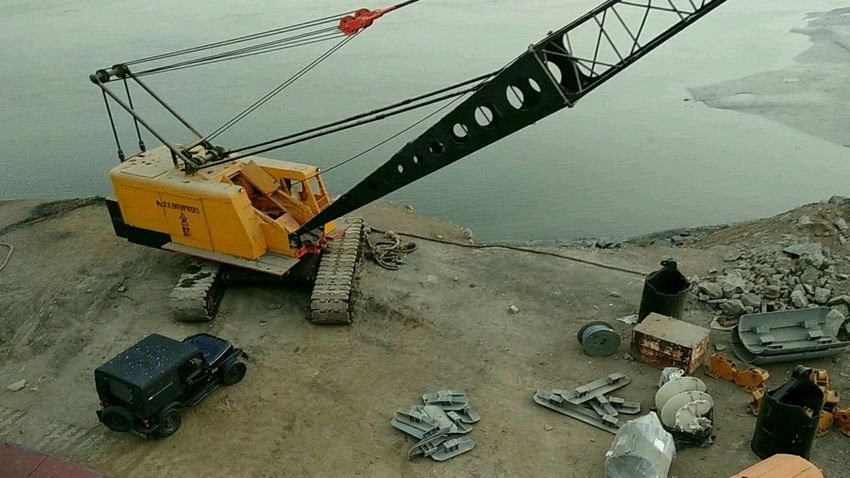 Flying High EyeEmNewHere No People Construction Site Crane - Construction Machinery Creekside Thar Jeep Mahindrathar Liveyounglivefree Yellow Black Trash