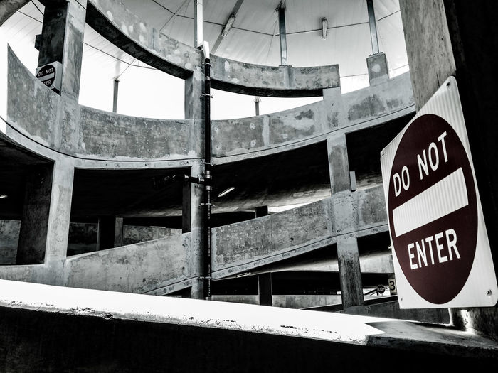 Do not enter sign on wall in parking lot