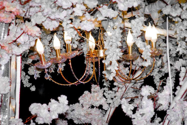 Close-up of illuminated lighting equipment on snow