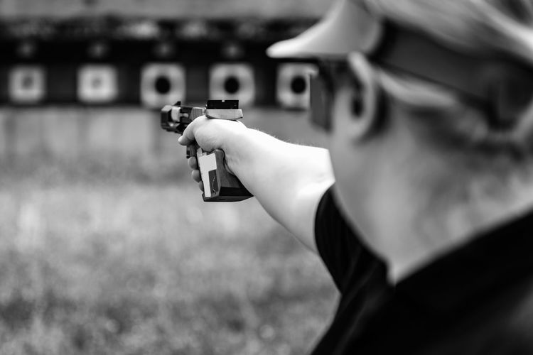 Woman On Sport Shooting Training Shooting Pistol Sport Shooting Gun Target Weapon Shooting A Weapon Practicing Sports Training Training Female Woman Outdoors Barrel Competitive Sport Competition Protective Eyewear Handgun Concentration Technique Aiming Equipment Black And White Black White