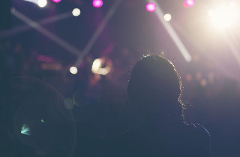 Concert dark background, smoke, spotlights. bright lights person
