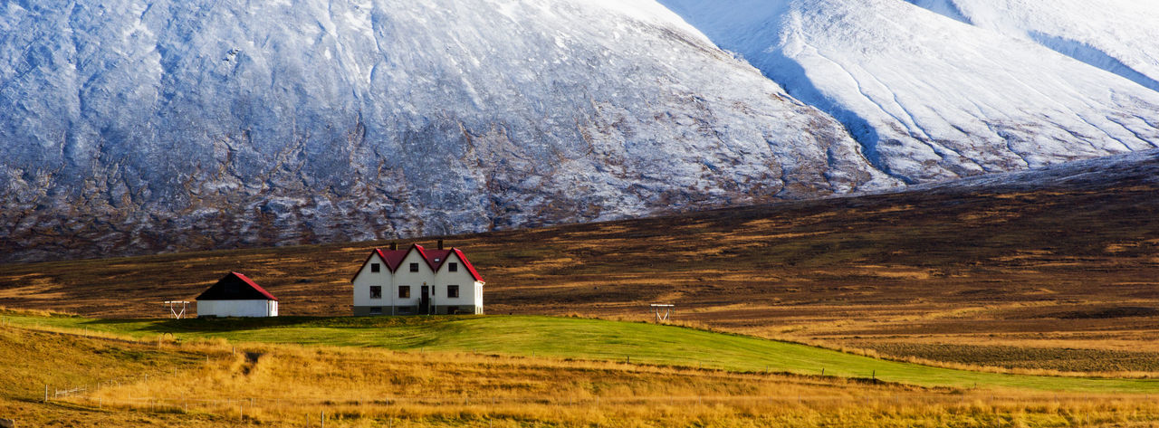 Mountain Scenics - Nature Environment Architecture Landscape No People Beauty In Nature Building House Built Structure Cold Temperature Tranquility Nature Snow Tranquil Scene Grass Non-urban Scene Outdoors Snowcapped Mountain Cottage Autumn Farm Farmhouses Remote Place