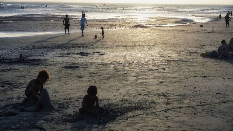 Beach Vacations Leisure Activity Sand Togetherness Water Tourism Tourist Lifestyles Shore Sea Person Travel Scenics Girls Sunset Childhood Tranquility Summer Wave Jericoacoara Ceará Brazil