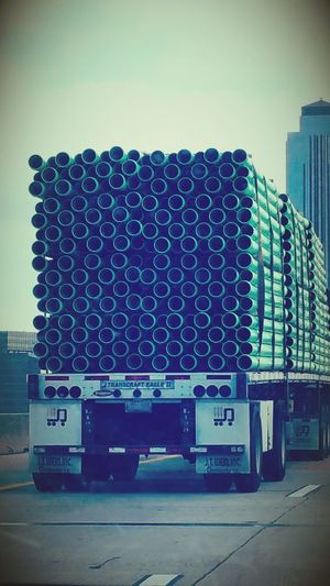 Pipes galore. 😆 That's kinda different. Stack Outdoors Day City Business Finance And Industry Trucks Hauling Stuff Full Frame Houston Texas Popular Photos Photos On The Street Pipes