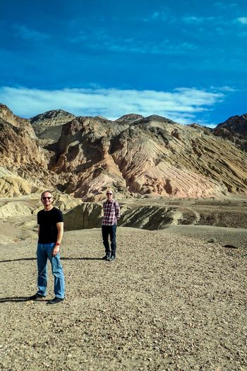 Lost In The Landscape Mountain Two People Sky Real People Day Casual Clothing Togetherness Full Length Outdoors Men Cloud - Sky Hiking Nature Mountain Range Landscape Leisure Activity Scenics Lifestyles Vacations Bonding Death Valley National Park USA