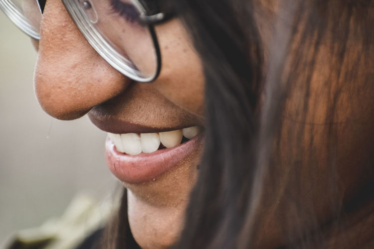 Close-up of smiling young woman wearing eyeglasses