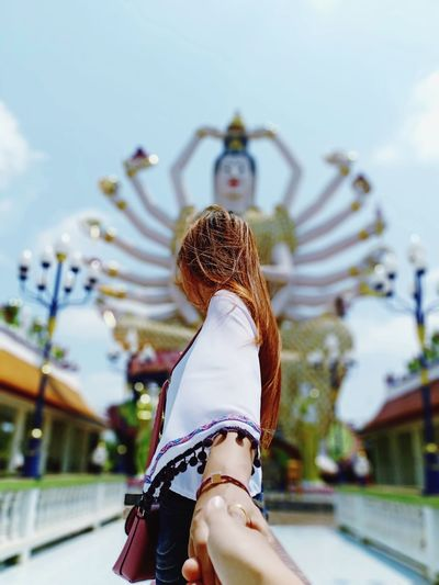 Rear view of woman in amusement park