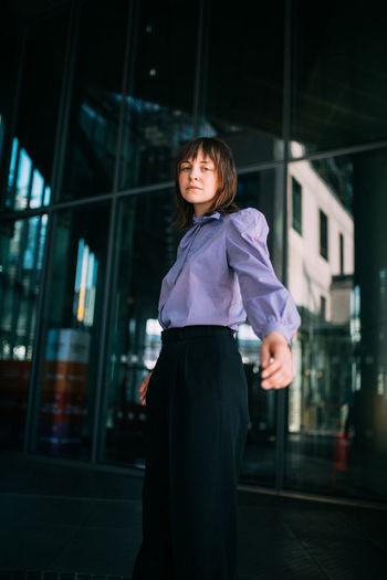 Portrait of woman standing in office