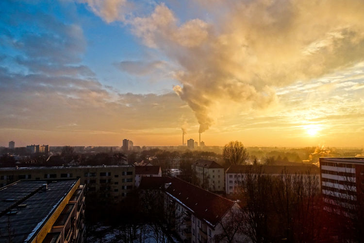 Residential buildings against polluted air at sunset