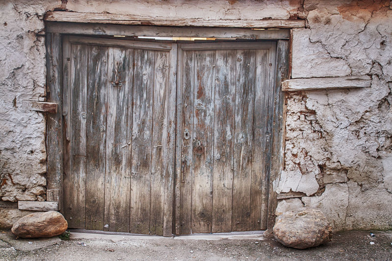 aged exterior wooden door and loam wall Ancient Doors Textured  Aged Architecture Background Building Exterior Built Structure Clay Wall Door House Loam Wall No People Old Outdoors Shabby Textured  Weathered Wood - Material Wooden