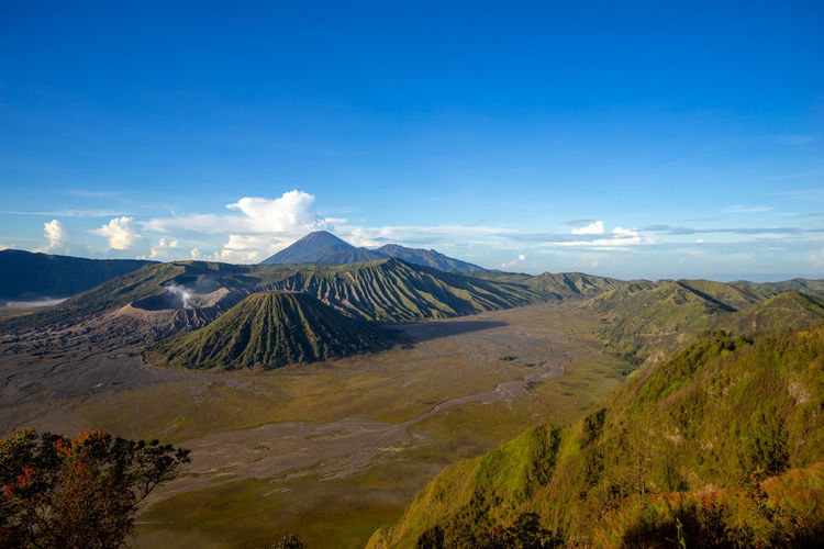 Beautiful view landscape of active volcano crater with smoke at mt. bromo, east java, indonesia.